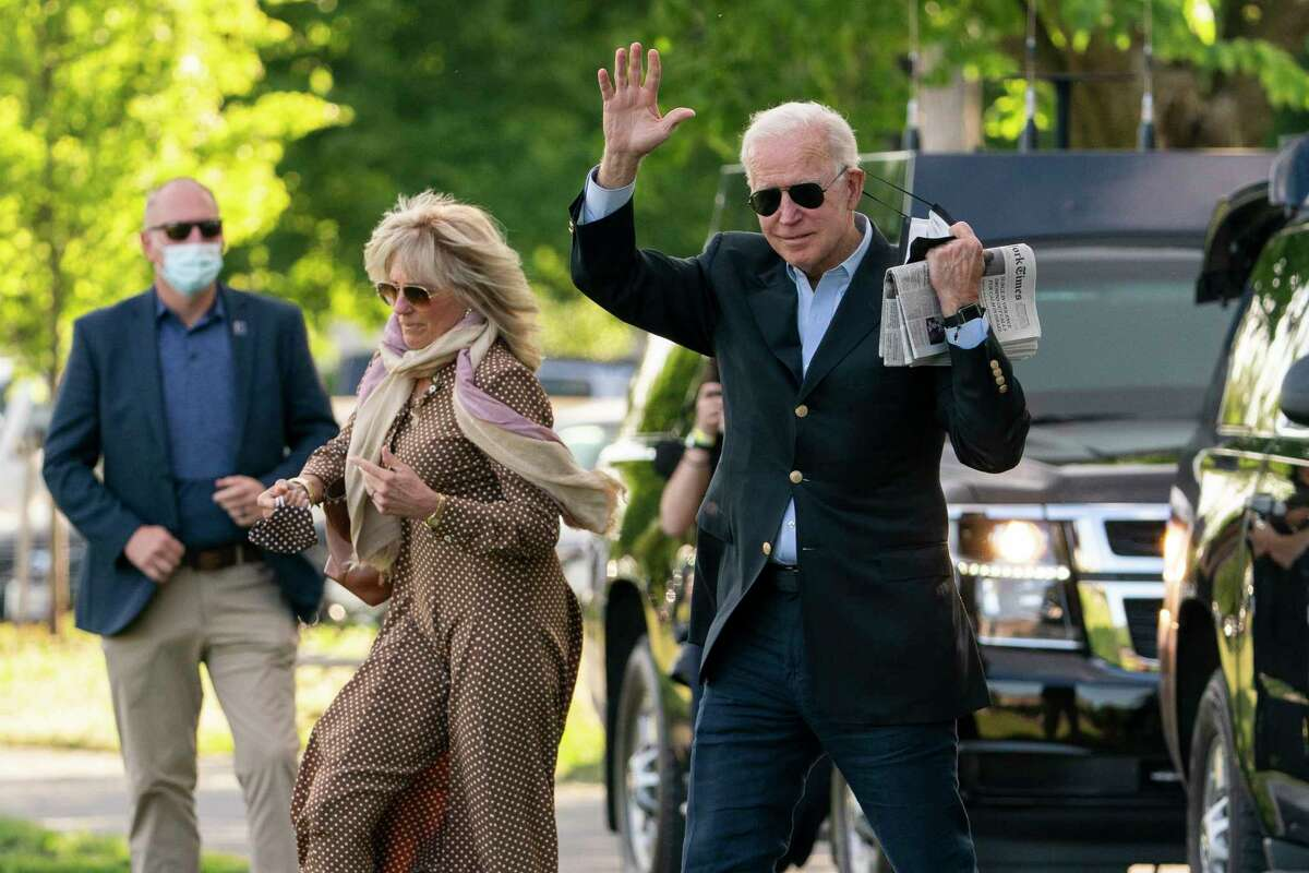 President Joe Biden with first lady Jill Biden waves as they walk on the Ellipse near the White House in Washington to board the Marine One, Saturday, May 15, 2021.