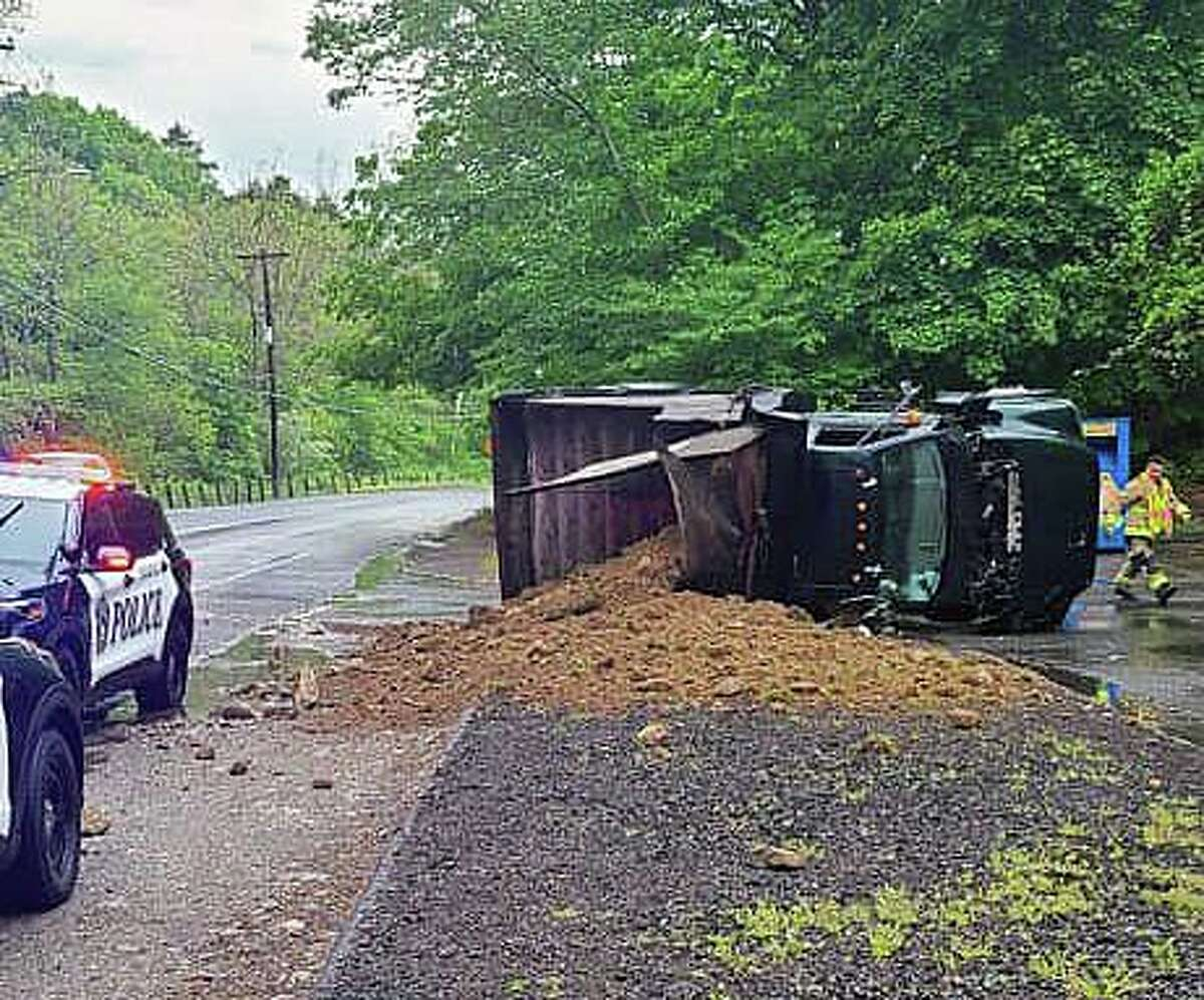 Crews at a crash with an overturned truck on Prospect Street in Naugatuck, Conn., on Sunday, May 16, 2021.