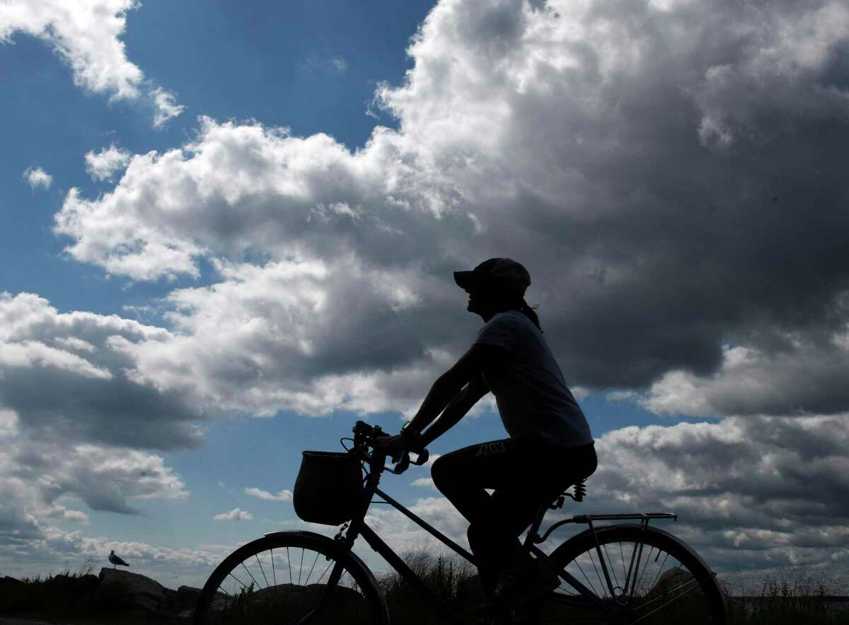 A file photo of a woman riding a bike in Old Greenwich, Conn.