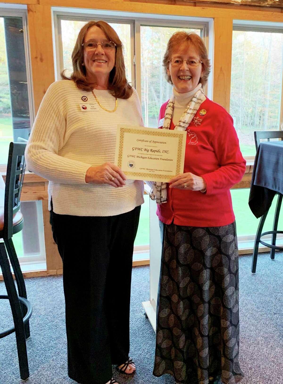 Pictured is GFWC Big Rapids President Ann Stellard and GFWC MI President Ruth Ann Northon honoring the club. (Courtesy photo)