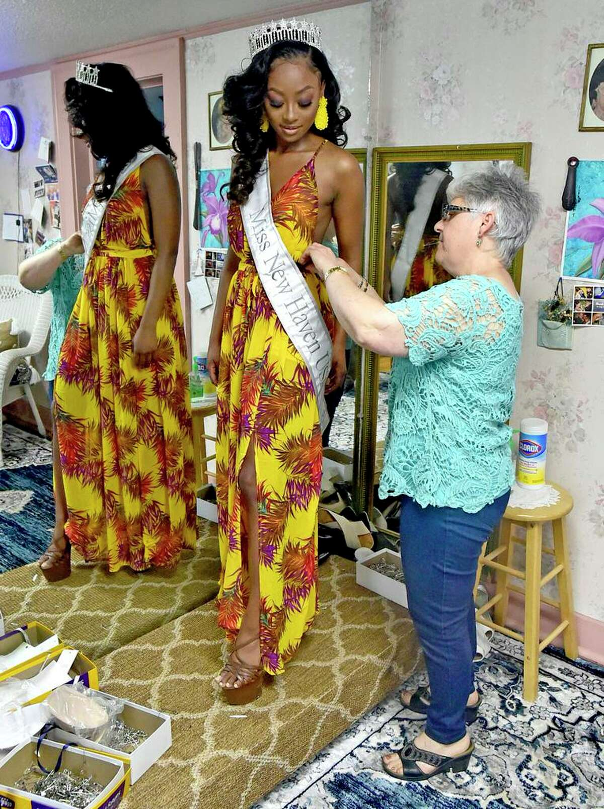 Branford, Connecticut - Wednesday, May 12, 2021: Seamstress Lucia Camarda, owner of Lucy Tailors of Branford, fits a competition dress for Miss New Haven USA , Khadesia Walker of New Haven for the Miss CT USA competition June 4-6.
