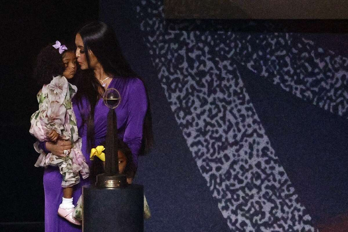 Vanessa Bryant holds her daughter Capri following the 2021 Basketball Hall of Fame Enshrinement Ceremony at Mohegan Sun Arena on May 15, 2021 in Uncasville, Connecticut.