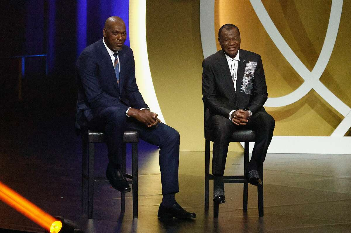 Class of 2020 presenters Calvin Murphy and Hakeem Olajuwon sit on-stage during the 2021 Basketball Hall of Fame Enshrinement Ceremony at Mohegan Sun Arena on May 15, 2021 in Uncasville, Connecticut.