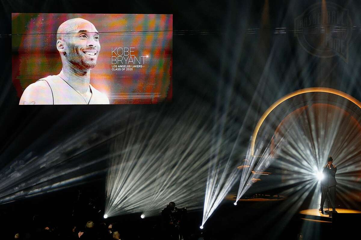 Musician Ne-Yo performs as the late professional basketball player and Class of 2020 inductee Kobe Bryant is honored during the 2021 Basketball Hall of Fame Enshrinement Ceremony at Mohegan Sun Arena on May 15, 2021 in Uncasville, Connecticut.