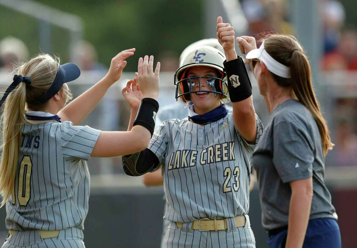 Kalee Rochinski #23 of Lake Creek get high-fives after scoring a run during a one-game Region III-5A quarterfinal game at Magnolia High School, Friday, May 14, 2021, in Magnolia.
