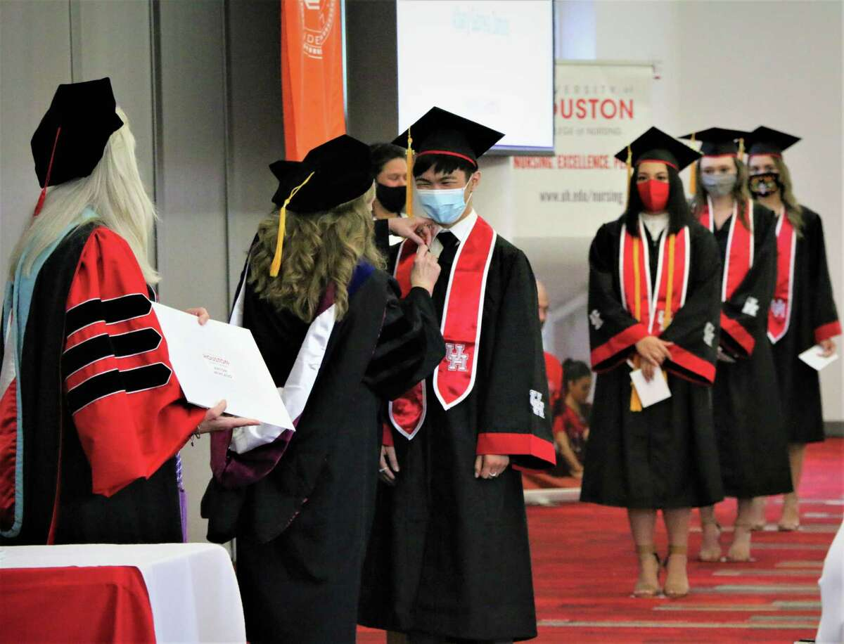 The first graduates from the UH-Katy College of Nursing walk the stage on May 14, 2021.