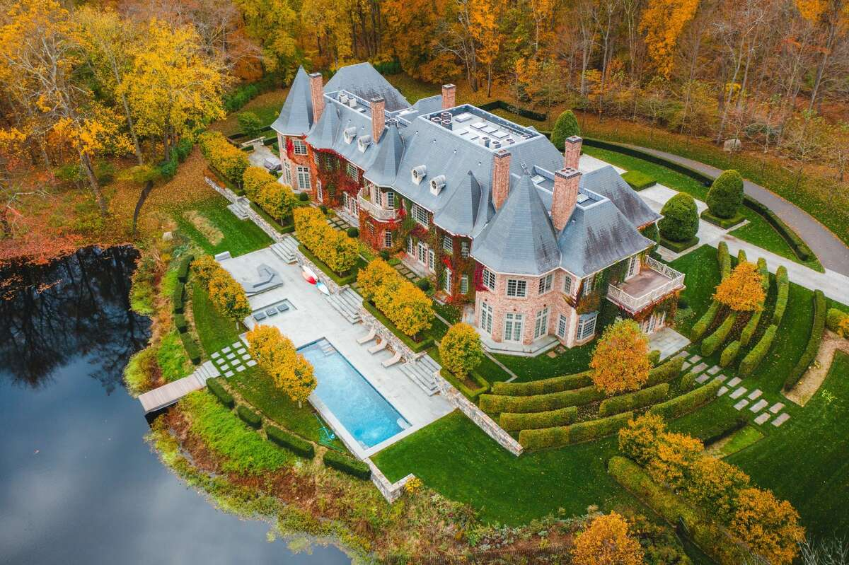 the seven-bedroom European-style brick chateau home at 266 Michigan Road in New Canaan is on the market for $15,000,000.