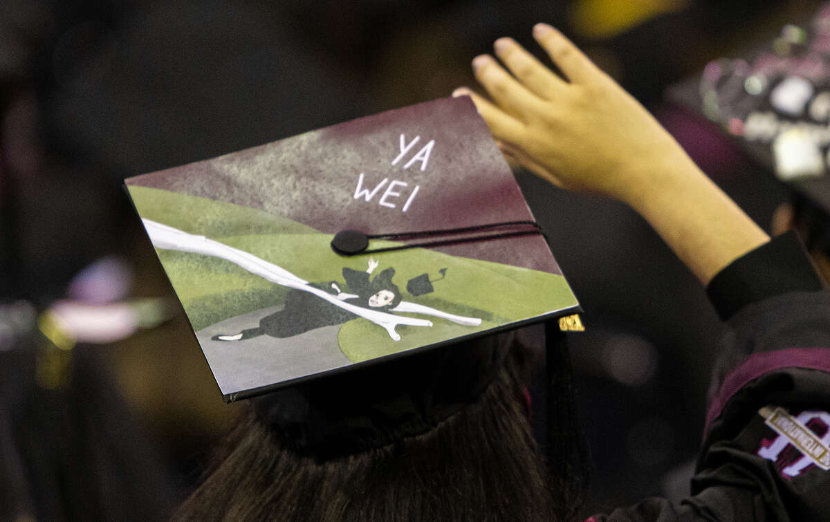 TAMIU graduates for the class of 2021 don their decorated caps, Friday, May 14, 2021, at the Sames Auto Arena during TAMIU's Spring Commencement Ceremony.