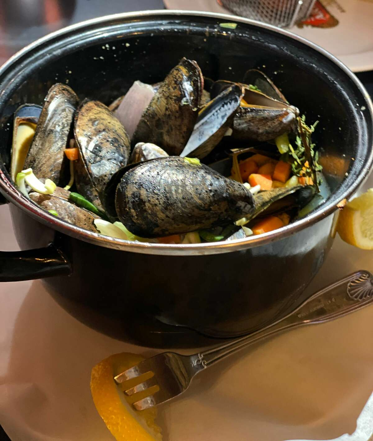 Mussels are served in their cooking pot with a light wine sauce at Brasserie Benelux in Saratoga Springs. (Susie Davidson Powell/For the Times Union)