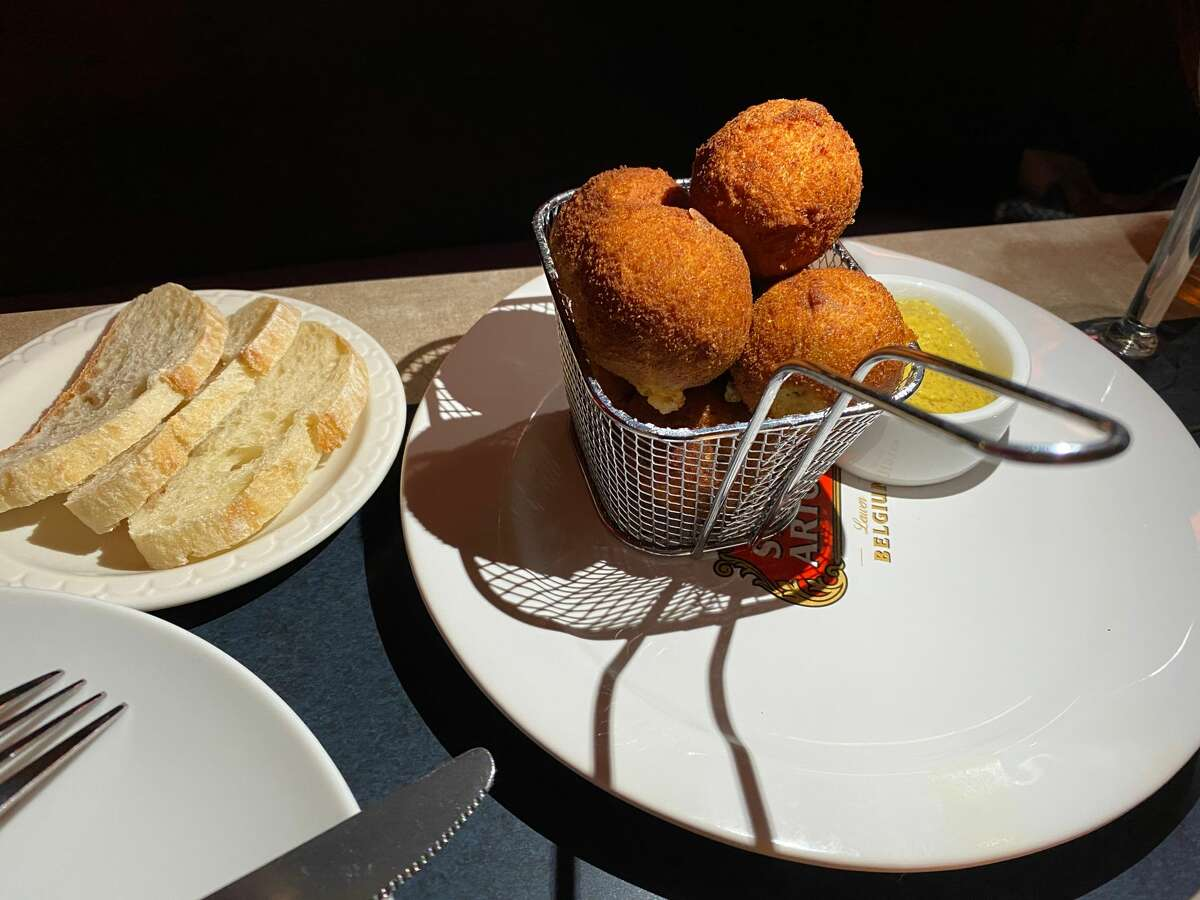 A meal highlight at Brasserie Benelux in Saratoga Springs is the Bitterballen croquettes, filled with sirloin and bechamel sauce. (Susie Davidson Powell/For the Times Union)