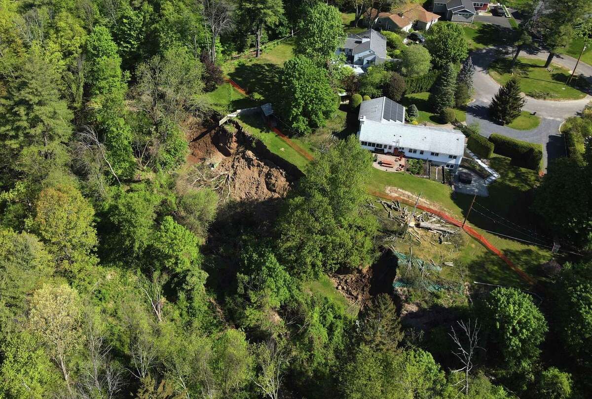 Scene of a landslide behind property on a cul-de-sac on Groesbeck Place on Monday, May 17, 2021, in Bethlehem, N.Y. The slide was one of the largest the town supervisor David VanLuven has seen in recent years. It dropped land more than 20 feet down and impacted an area about 300 feet wide, according to VanLuven. (Will Waldron/Times Union)