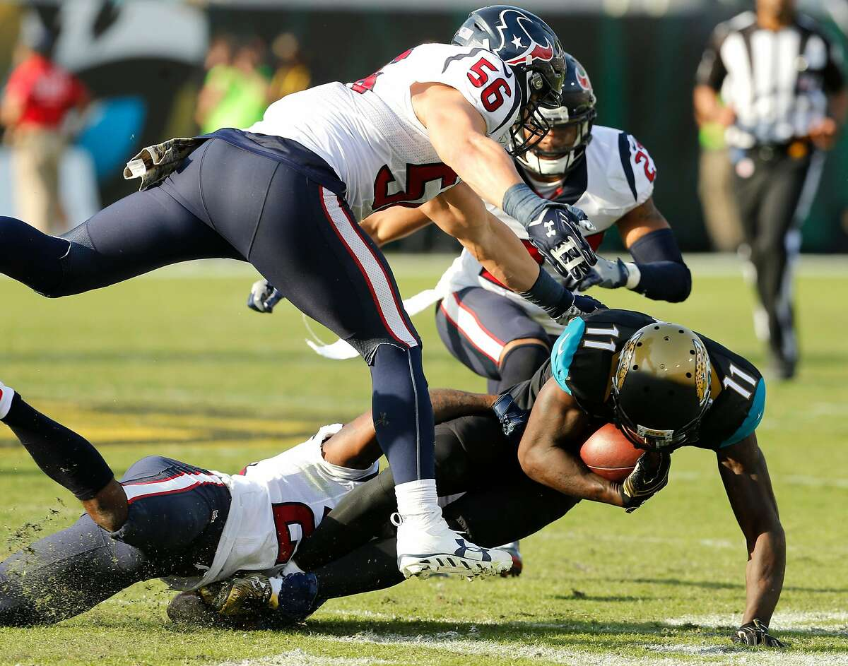 Jacksonville Jaguars wide receiver Marqise Lee (11) is tackled by Houston Texans cornerback Johnathan Joseph (24), inside linebacker Brian Cushing (56) and strong safety Quintin Demps (27) during the fourth quarter of an NFL football game at Everbank Field on Sunday, Nov. 13, 2016, in Jacksonville. ( Brett Coomer / Houston Chronicle )