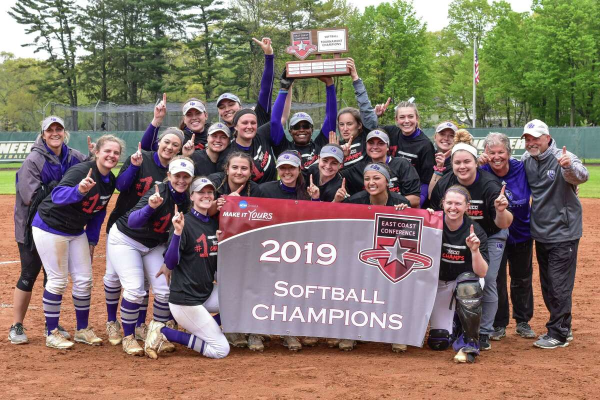 Members of the Bridgeport softball team celebrate after winning the school's first-ever East Coast Conference Championship on Saturday.