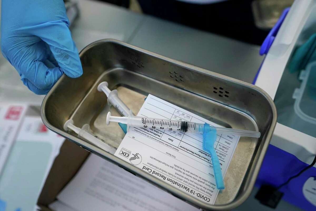 Syringes filled with coronavirus vaccine are shown at a mobile clinic.