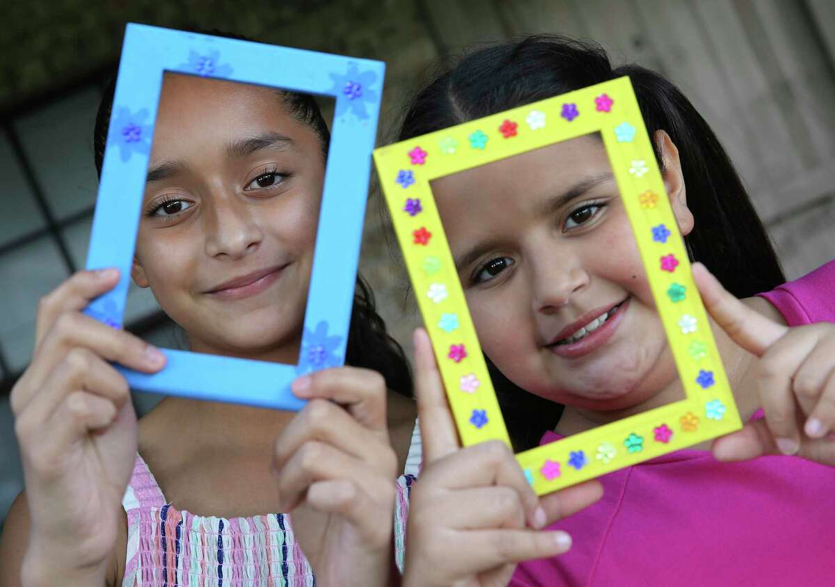South Side sisters Bella (left) and Ruby Cortez, aka the Crafty Cortez Sisters, make crafts and charm customers with their entrepreneurial spirit. Bella, 11, and Ruby, 10, use their imagination to create picture frames, charm bracelets, barrettes, headbands and necklaces that they have been selling over the past year.