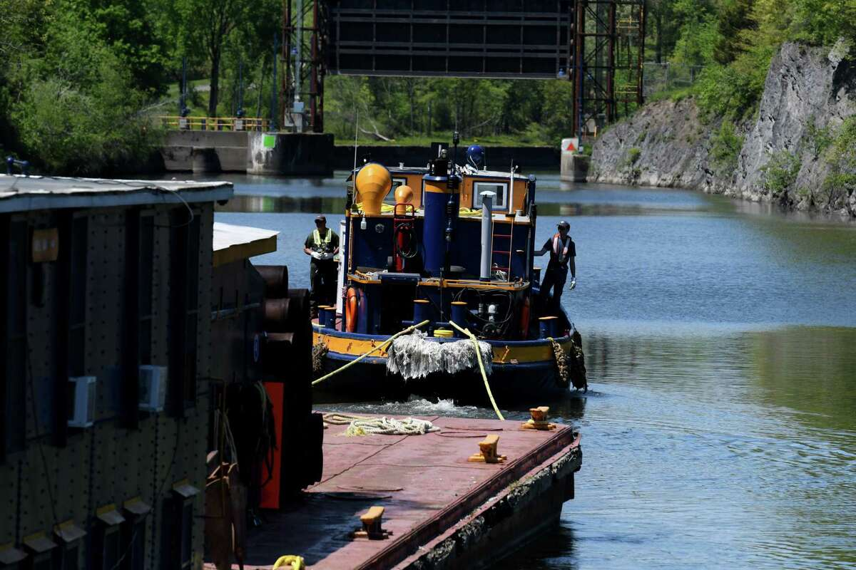 New York State Canal Corporation equipment is moved through the flight lock system out of Erie Canal Lock 6 on Monday, May 17, 2021, in Waterford. (Will Waldron/Times Union)