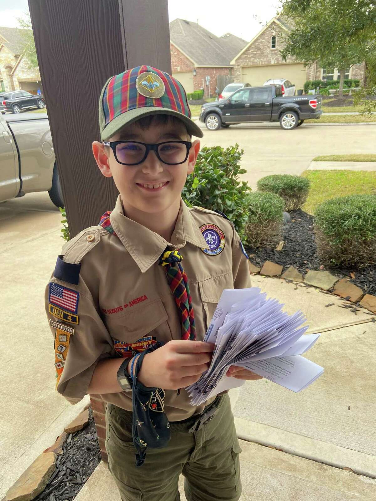 Tristan Davis, who turns 10 this month, distributes flyers in his Katy neighborhood to later collect pet food and supplies for animals at Citizens for Animal Protection.