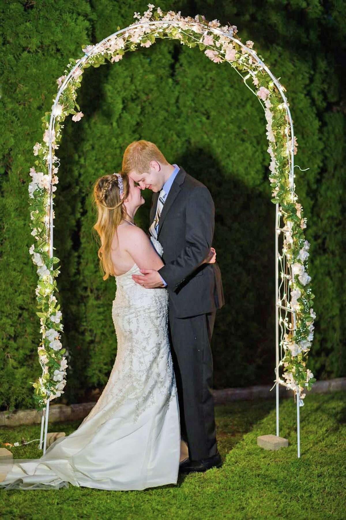 Christina and Jesse Rathbun pose for a photo at their small wedding of 30 people on Sept. 5, 2020. To accommodate their original 120-person list, the couple is hopeful about holding an upcoming vow renewal and reception party on Sept. 4, 2021. The COVID-19 pandemic has put a wrench in many wedding plans.
