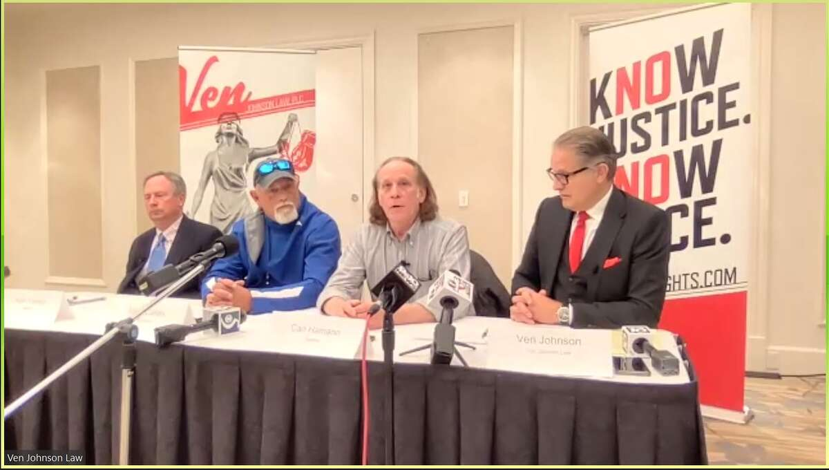 From left to right:Flood victims Kurt Yockey ,Mike Callan, and Carl Hamann, along with attorney Ven Johnson, speak at a press conference on May 17, 2021.