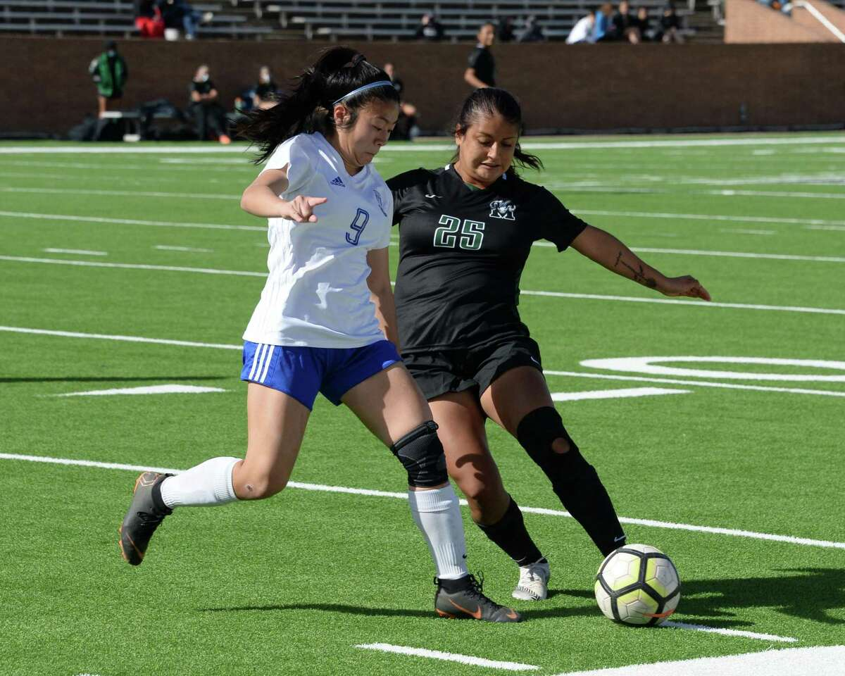 Meybelin Ponce (25) of Mayde Creek is challenged by Brooke Le (9) of Westbrook as she pass a ball during the first half of the Ram Bracket Championship game of the I-10 Shootout between the Mayde Creek Rams and the Westbrook Wildcats on Saturday, January 16, 2021 at Rhodes Stadium, Katy, TX.