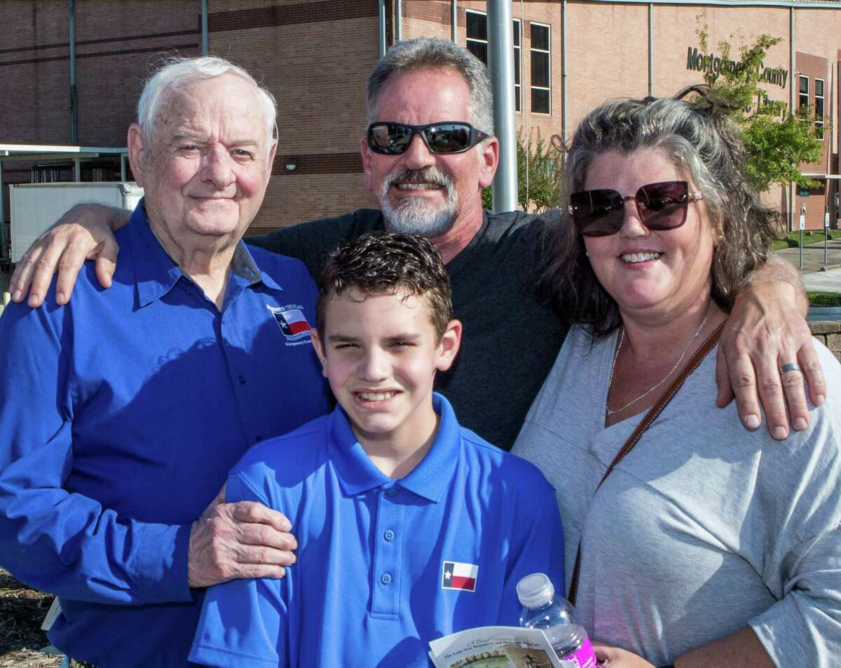 Jim Walker is pictured with his daughter, son-in-law and grandson at the 2020 Flag Raising Ceremony at the Lone Star Monument & Historical Flag Park.