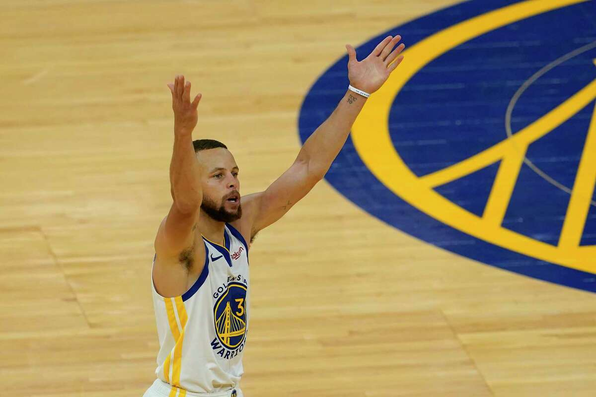 Golden State Warriors guard Stephen Curry gestures after shooting a 3-point basket against the Memphis Grizzlies during the second half of an NBA basketball game in San Francisco, Sunday, May 16, 2021.