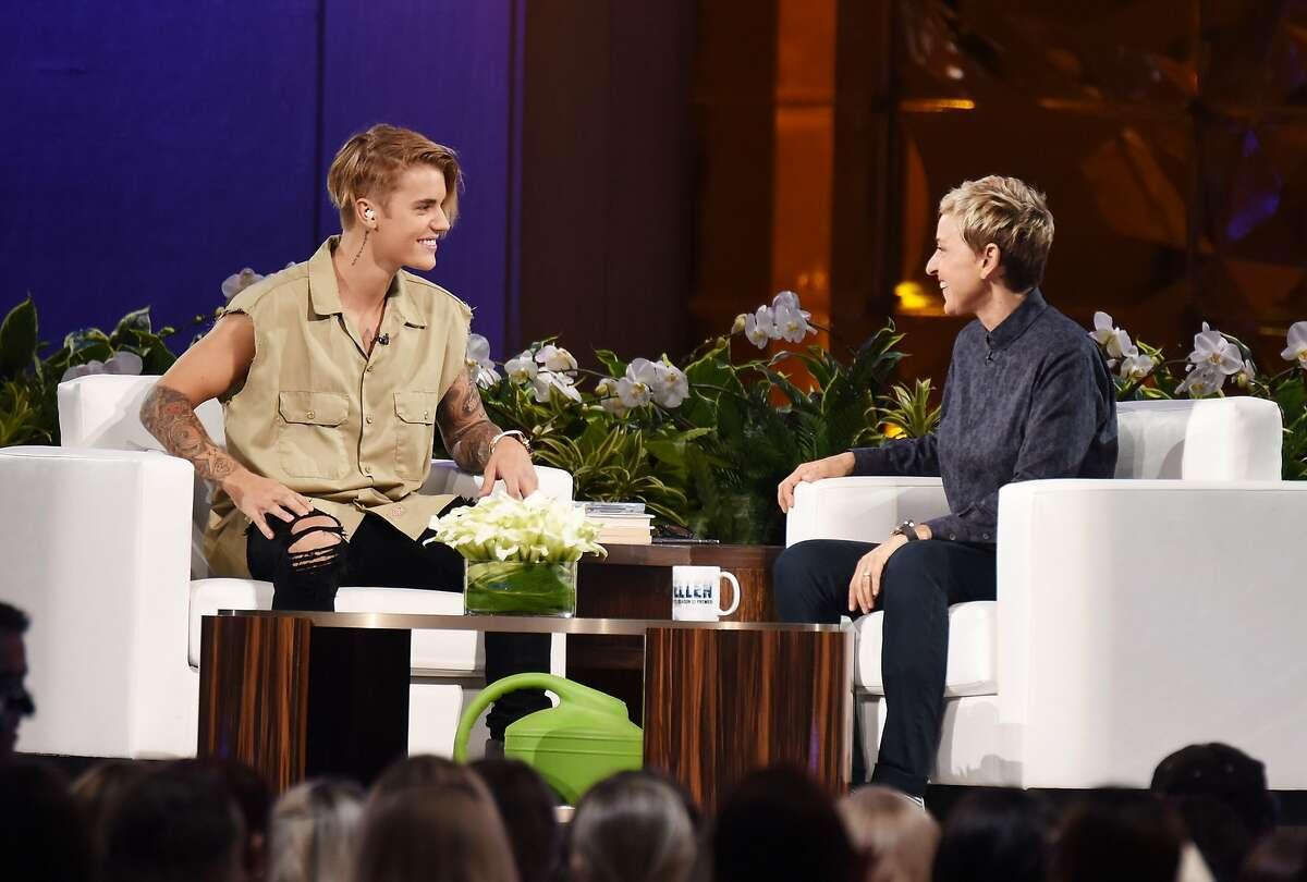 "Justin Bieber, left, and Ellen DeGeneres appear at ""The Ellen Degeneres Show"" Season 13 Bi-Coastal Premiere at Rockefeller Center on Sept. 8, 2015, in New York. (Dave Kotinsky/Getty Images/TNS)"