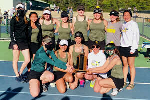Members of Dow High's girls' tennis team pose with the championship trophy after winning a 23rd consecutive Saginaw Valley League title last Thursday, May 13, 2021. The Chargers are (front, from left) Zoe Angell, Elise Ingalla, Salma Elsaadany, Emily Telgenhoff, Dana Winslow; and (back, from left) Laura Leiti, Emilia Ingalla, Maggie Nelson, Olivia Cross, Savannah Matuszewski, Claire Earley, Mallory Matthews, and Sofia Gestiada. Not pictured are Abigail Ahn and Andrea Vargas.