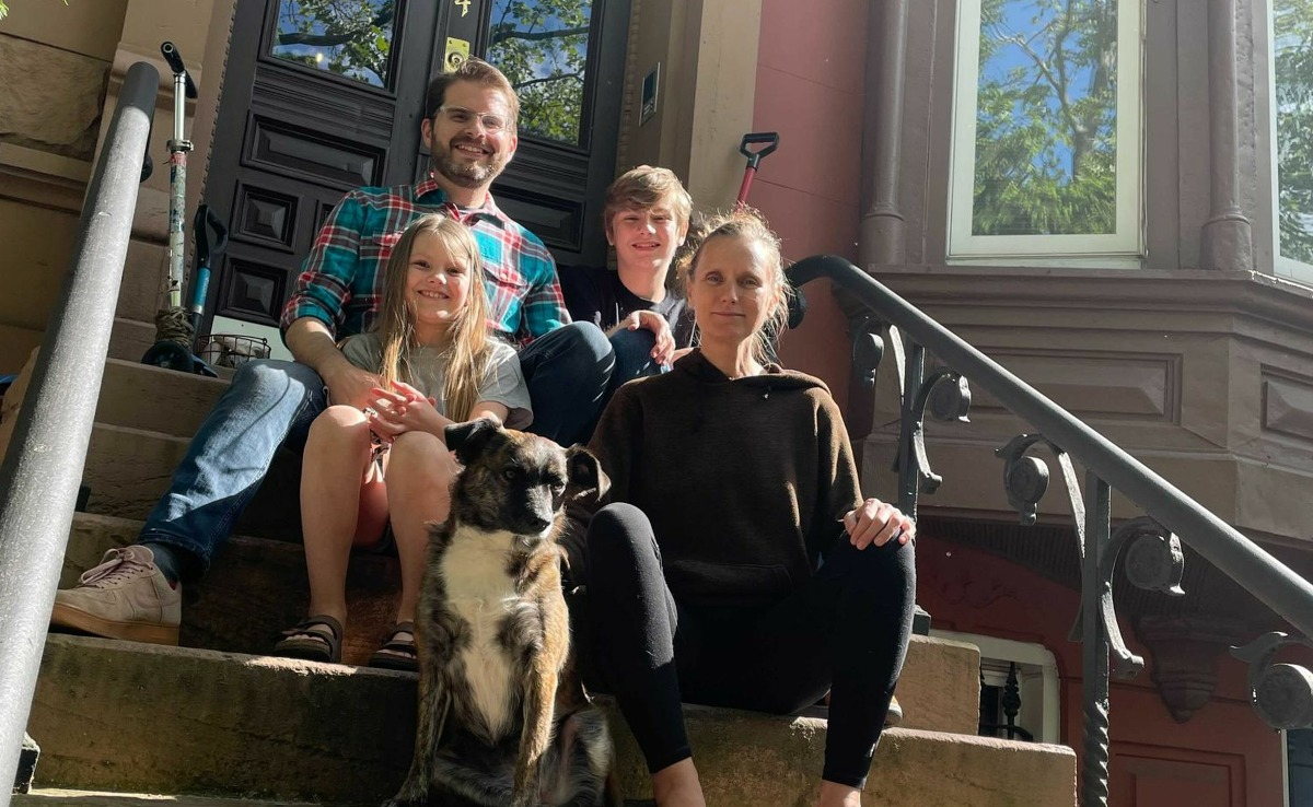 Bill Carbone (upper left) with 9-year-old daughter Veda (lower left), 14-year-old son Taavi (upper right), wife Amy Tate (lower right) and dog Shiloh B. Dinkins(lower center) on the steps of the brownstone in Brooklyn, N.Y. The family will be moving to Guilford, Conn. in June.
