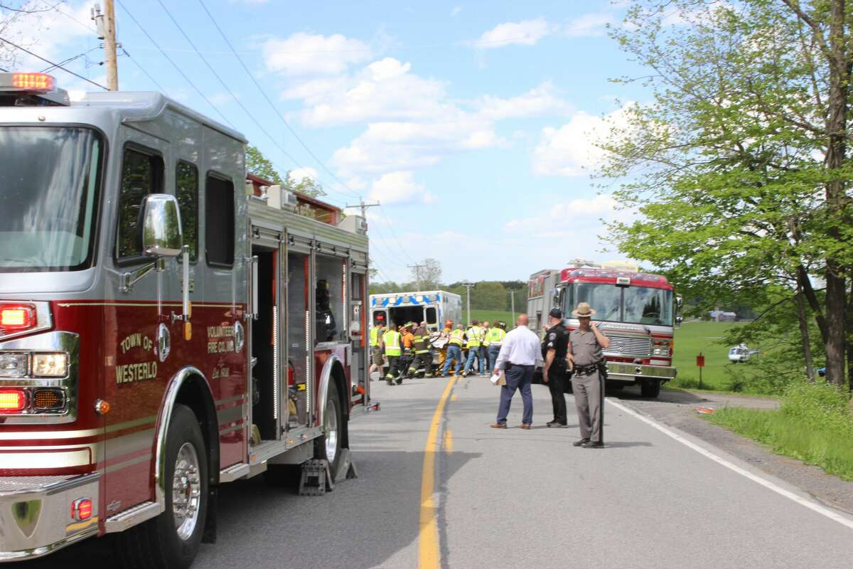 State Police and volunteer firefighters investigate the scene of a vehicle crash on Sunday, May 16, 2021, in Westerlothat sent several people to the hospital. One of the drivers was charged with driving while intoxicated and state troopers said additional charges were likely.