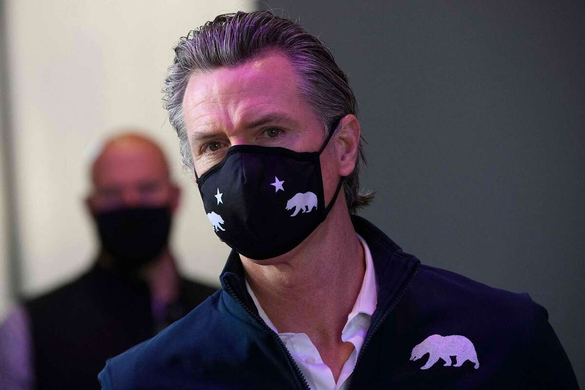 California Gov. Gavin Newsom wears a face mask as he prepares to give a briefing after touring a COVID-19 vaccination site on Feb. 22, 2021 in Long Beach, Calif.