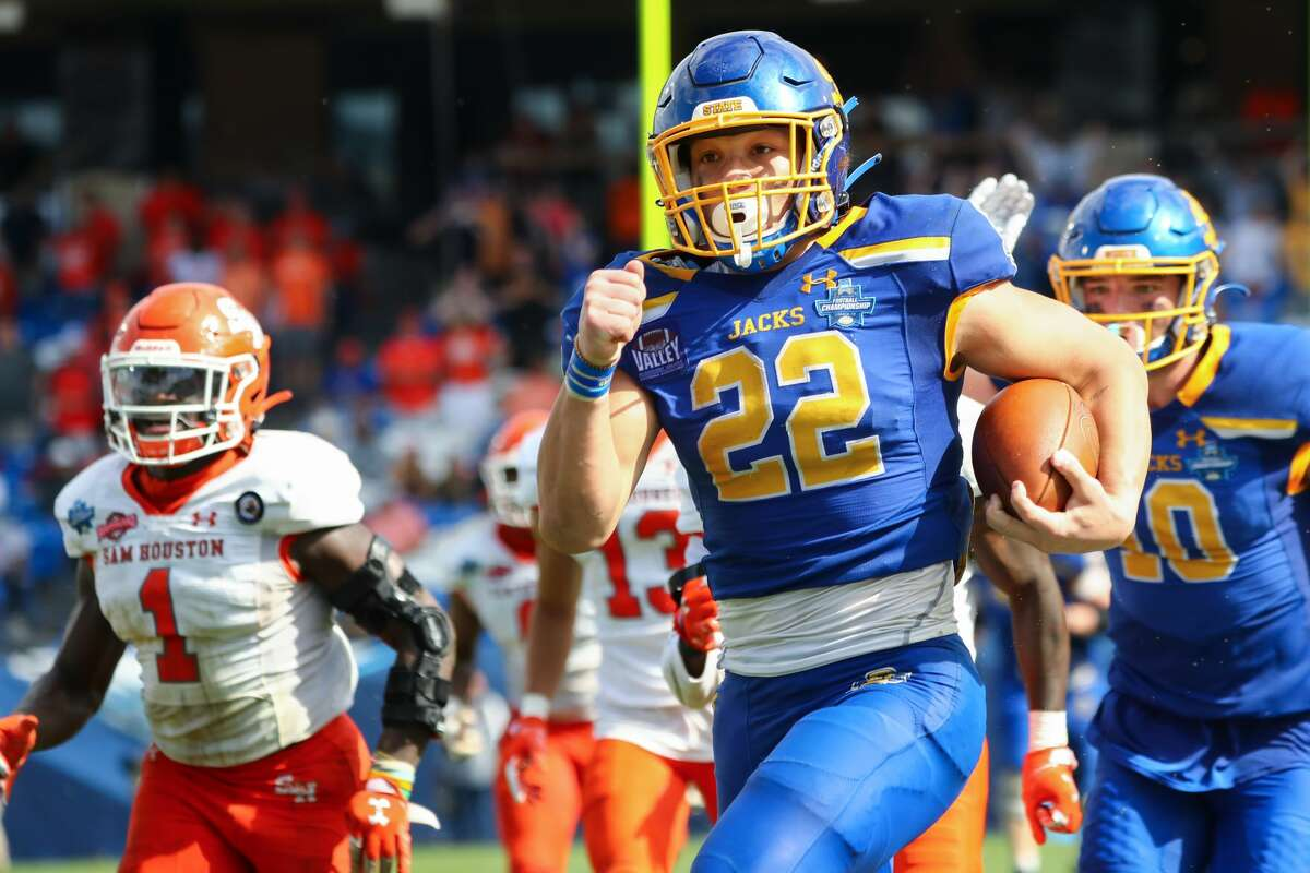 FRISCO, TX - MAY 16: Isaiah Davis #22 of the South Dakota State Jackrabbits runs for a touchdown against the Sam Houston State Bearkats during the Division I FCS Football Championship held at Toyota Stadium on May 16, 2021 in Frisco, Texas. (Photo by C. Morgan Engel/NCAA Photos via Getty Images)