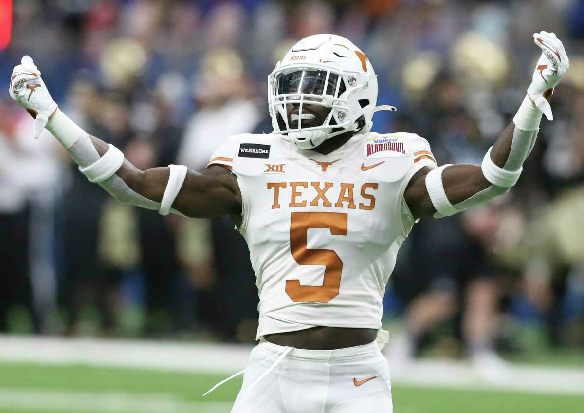 Longhorn running back D'Shawn Jamison celebrates with the crowd during the first quarter as Texas plays Colorado in the Alamo Bowl at the Alamodome on Dec. 29, 2020.