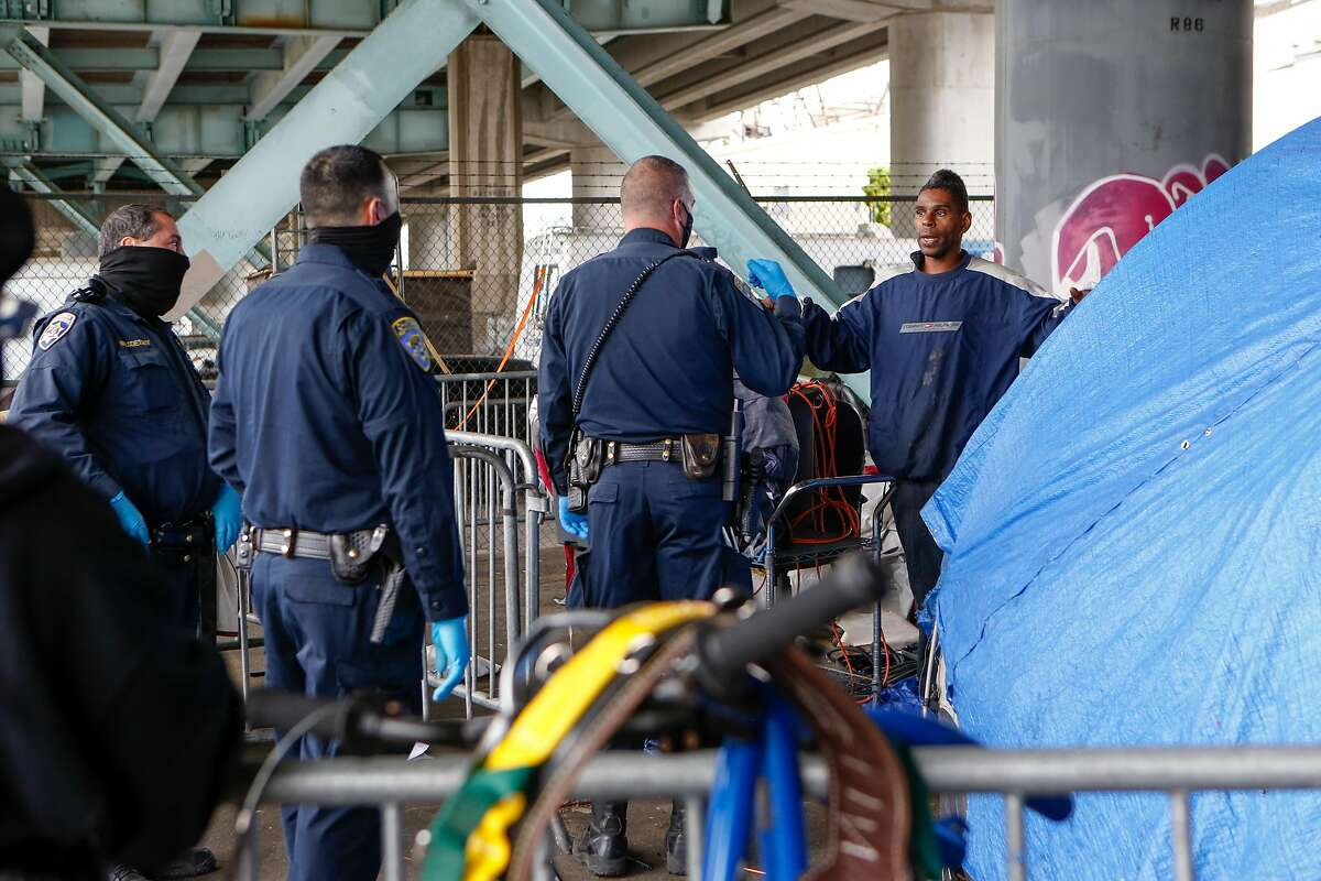 Officers insist to Ashante Jones that he needs to move his belongs immediately at the Merlin Street encampment just before a sweep performed by California Highway Patrol and CalTrans on Monday, May 17, 2021 in San Francisco, Calif.