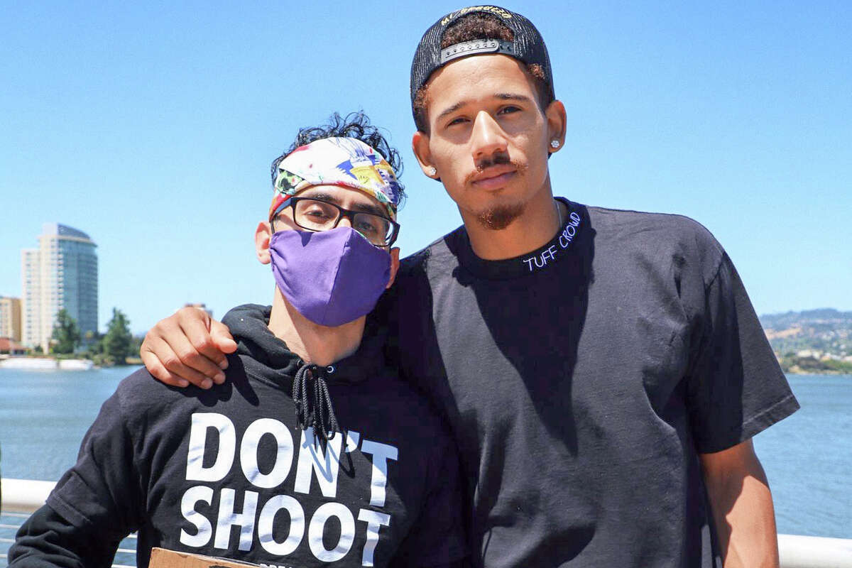 SFGATE contributor Alan Chazaro and Warriors forward Juan Toscano-Anderson at a Black Lives Matter protest in Oakland.