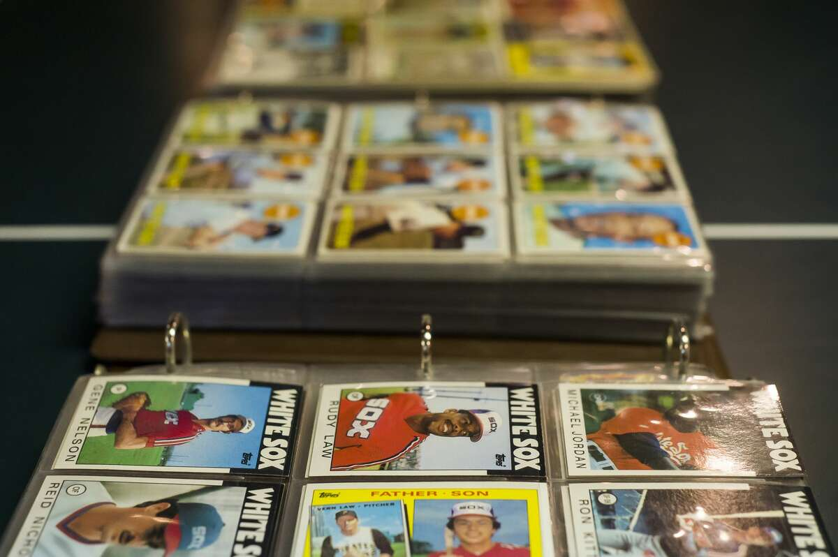 Rick Ohle's vast collection of Chicago sports memorabilia includes approximately 1,300 White Sox baseball cards by Topps. The collection is stored in the basement of his Midland home Thursday, May 13, 2021. (Katy Kildee/kkildee@mdn.net)
