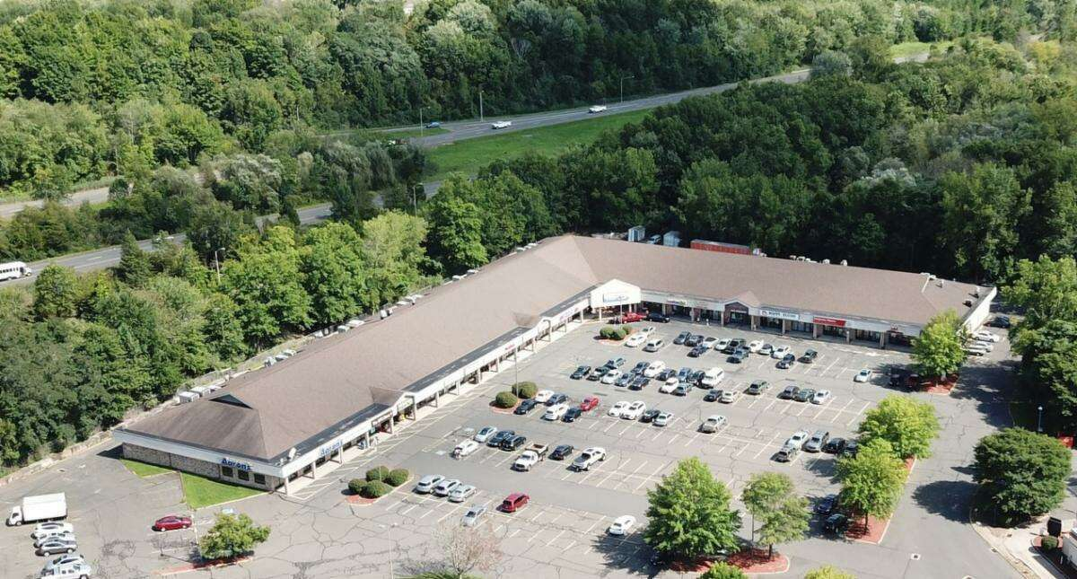 A 57,000 square foot shopping center on Shunpike Road has been sold for $5.1 million.