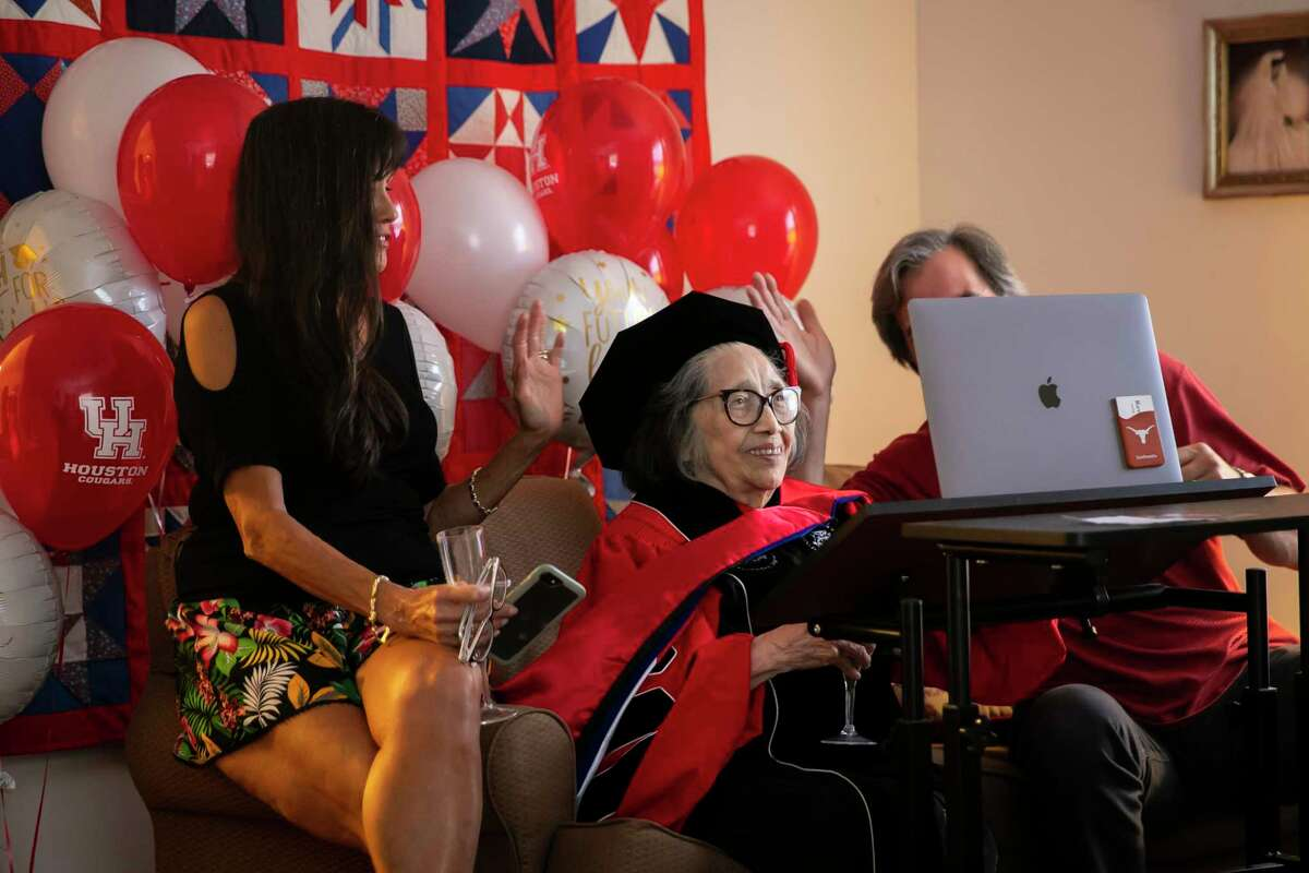 Esther Campos, 90, says goodbye to virtual guests during a graduation reception in Campos's home on Sunday, May 16, 2021.