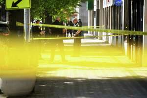 Yellow police tape marks off the crime scene as Bridgeport police investigate a double homicide that happened at a party about 2 a.m. May 16 in the heart of downtown Bridgeport. An off-duty rookie Bridgeport cop who was at the party and lost her badge there has been terminated from the force.