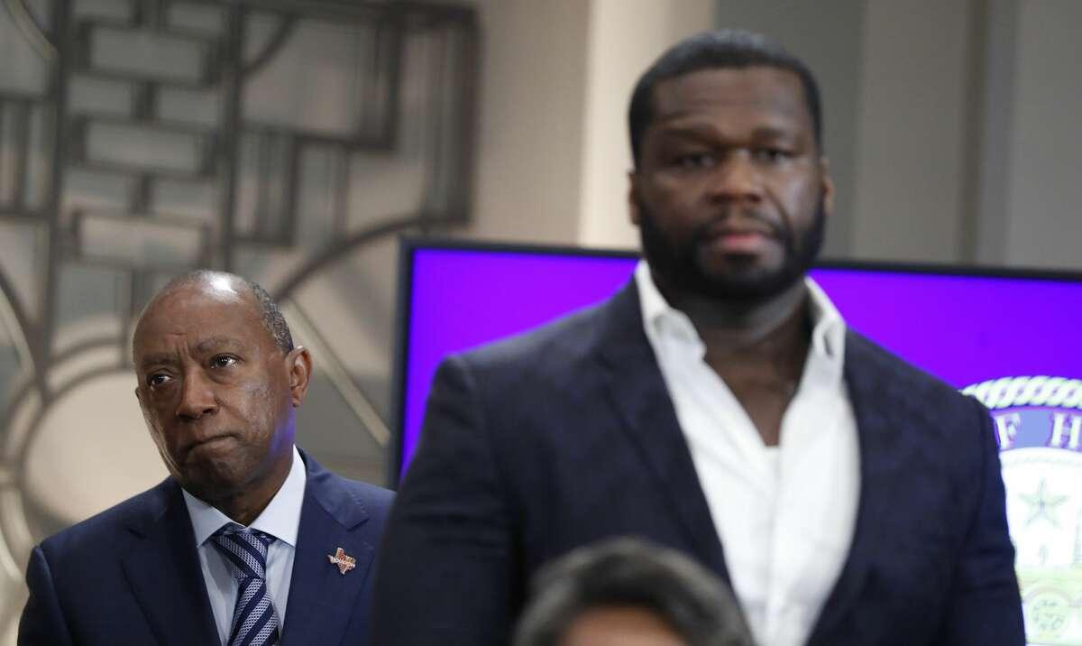 Mayor Sylvester Turner stands behind Curtis
