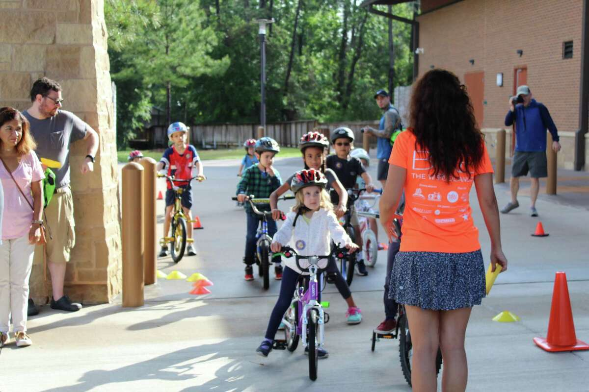 Fernanda Suarez, with Bike The Woodlands Coalition, leads children on a walk through demonstration of the bicycle course during the Kids Bike Rodeo in 2019.