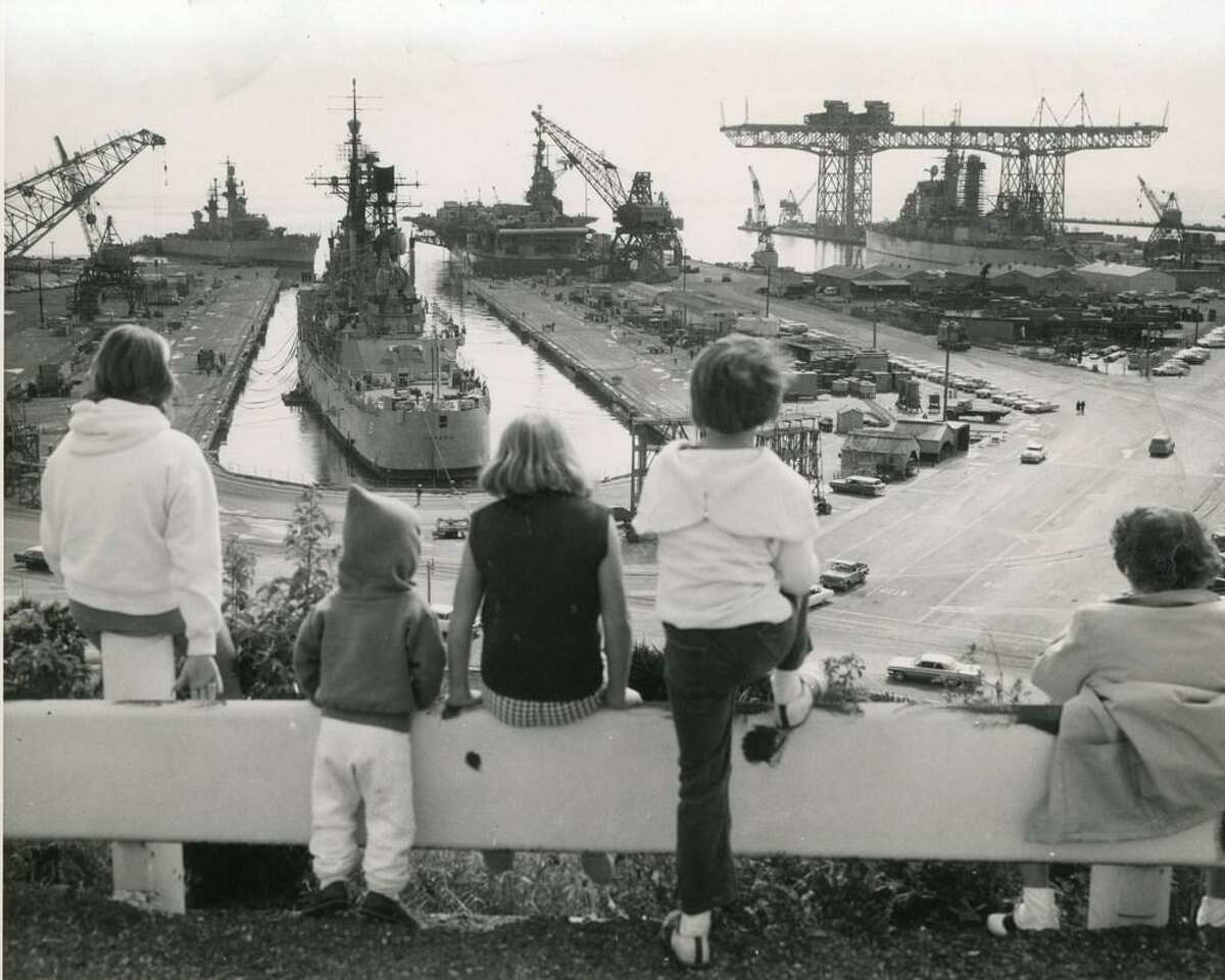 June 17, 1964: Children look out over the Hunters Point Naval Shipyard and Hunters Point crane.