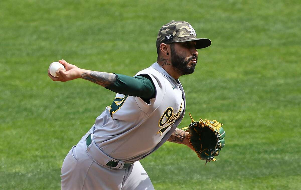 MINNEAPOLIS, MINNESOTA - MAY 16: Sergio Romo #54 of the Oakland Athletics pitches in the seventh inning against the Minnesota Twins at Target Field on May 16, 2021 in Minneapolis, Minnesota.(Photo by Adam Bettcher/Getty Images)