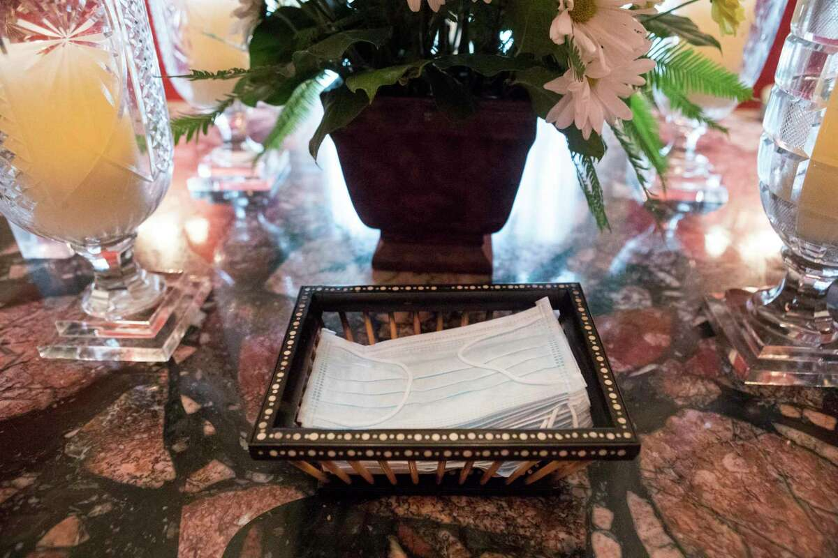 Face masks are made available in the foyer for clients at Bradshaw-Carter funeral home Monday, May 17, 2021 in Houston.