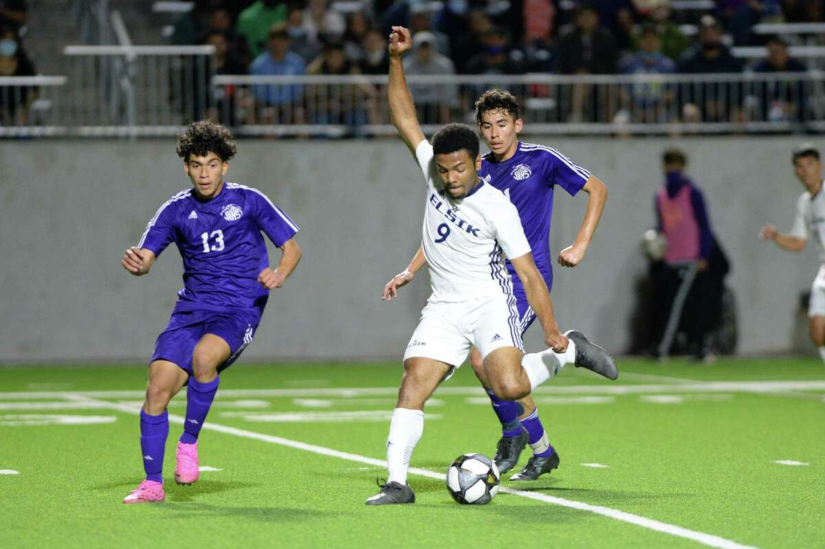 Brian Obaseki (9) of Elsik takes a shot on goal during the second half of a 6A-III regional semifinal soccer match between the Elsik Rams and the Jersey Village Falcons on Tuesday, April 6, 2021 at Legacy Stadium, Katy, TX.