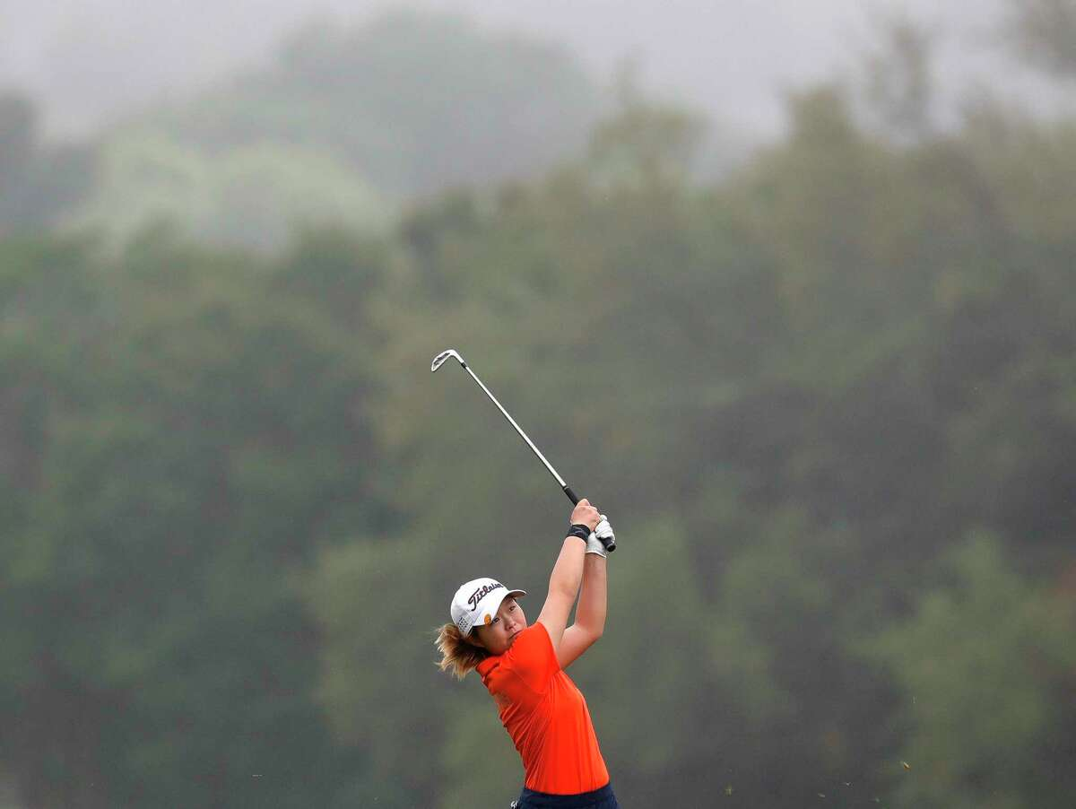 Maelynn Kim of Seven Lakes hits her second shot on the 9th fairway in light fog during the Class 6A girls UIL State Golf Championship at Legacy Hills Golf Club, Tuesday, May 11, 2021, in Georgetown.