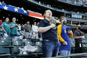 SEATTLE, WASHINGTON - MAY 15: Fans stand for the national anthem before the game between the Seattle Mariners and the Cleveland Indians at T-Mobile Park on May 15, 2021 in Seattle, Washington. (Photo by Steph Chambers/Getty Images)