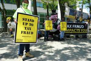 Torrington's Ana Cardona rallies with fellow members of the state carpenter's union outside the Government Center in Stamford, Conn. Monday, May 17, 2021. The United Brotherhood of Carpenters and Joiners rallied to shine a light on tax fraud violations they claim are taking place on worksites across the city.