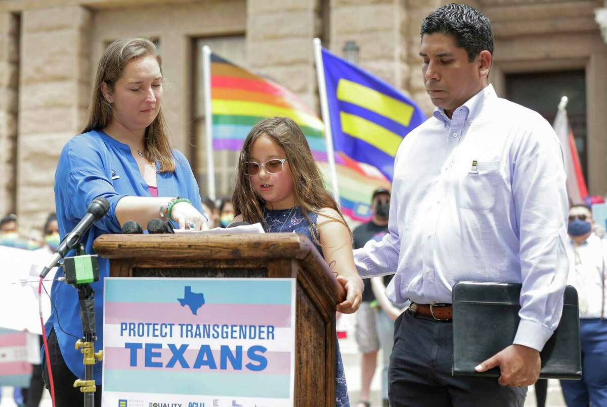 Surrounded by her parents Rachel and Frank Gonzales, 8-year-old Cecilia Gonzales speaks out against bills that would criminalize gender-affirming medical care for her transgender sister at a rally at the Texas State Capitol on Tuesday, May 4, 2021 in Austin. (Erich Schlegel/AP Images for Human Rights Campaign)