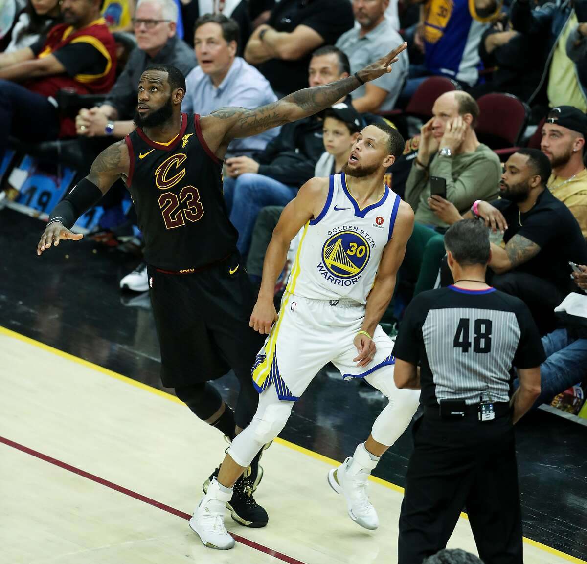 Golden State Warriors' Stephen Curry and Cleveland Cavaliers' LeBron James watch a Curry shot in the fourth quarter during game 4 of The NBA Finals between the Golden State Warriors and the Cleveland Cavaliers at Quicken Loans Arena on Friday, June 8, 2018 in Cleveland, Ohio.